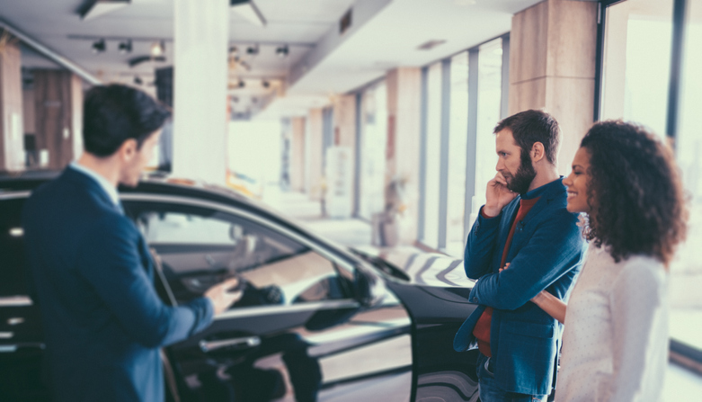 At the dealership, evaluate the car and the salesperson. (Photo from Getty Images)